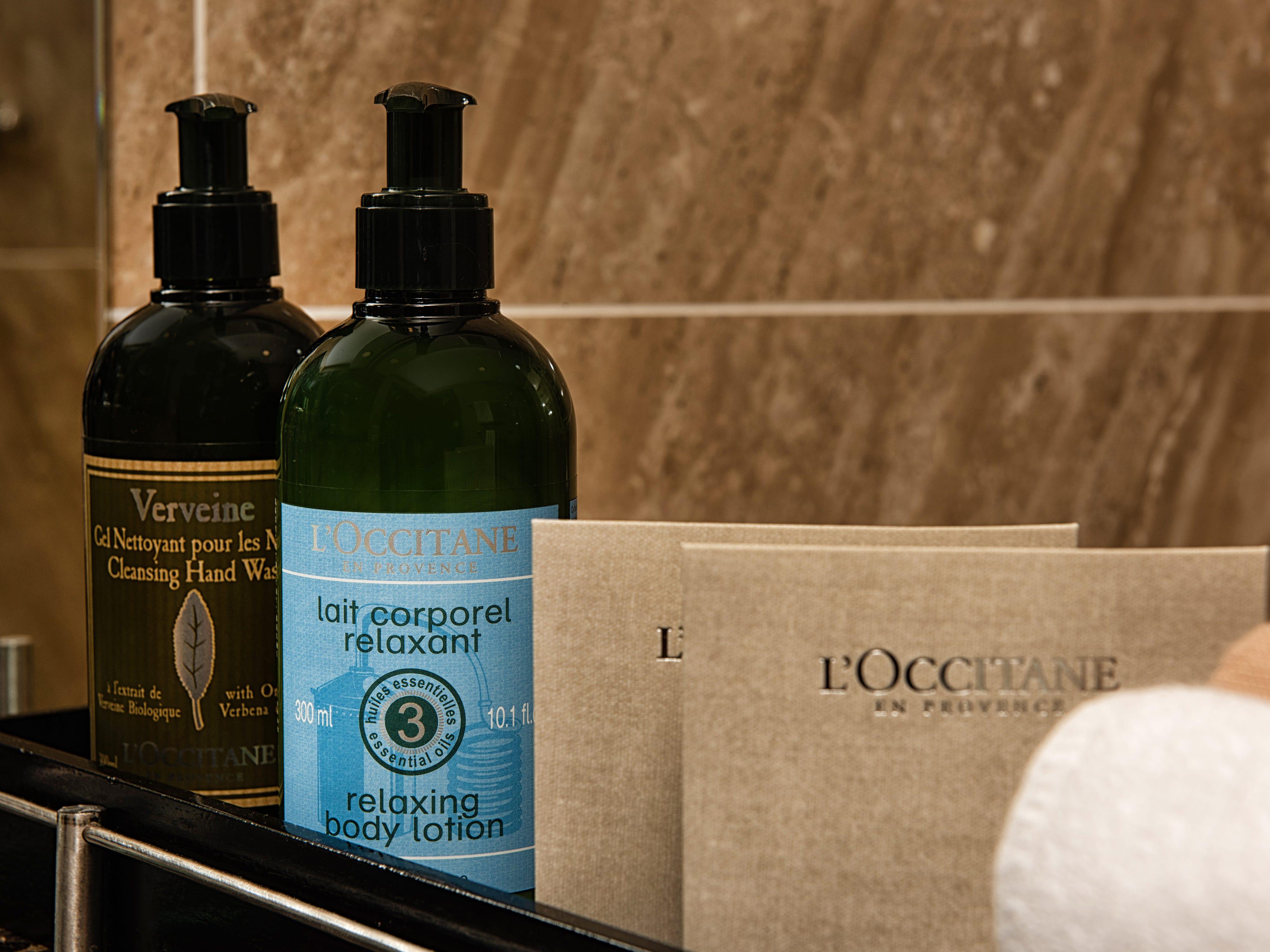 Avalon Saigon suite bathrooms feature upscale L'Occitane products.