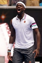 Frances Tiafoe celebrates after defeating Kevin Anderson.