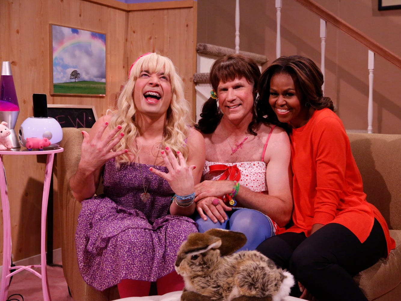 """ANY AP HANDOUT PHOTO OVER 30 DAYS OLD MUST BE CHECKED AGAINST AP ARCHIVE FOR USAGE RIGHTS. DO NOT PUBLISH WITHOUT PHOTO EDITOR CONFIRMATION. From left: Host Jimmy Fallon, actor Will Ferrell, First Lady Michelle Obama during the """"Ew"""" skit on Thursday Feb. 20, 2014 during comedian Fallon's inaugural week as the new """"Tonight Show"""" host. (AP Photo/NBC, Lloyd Bishop) ORG XMIT: NY110"""