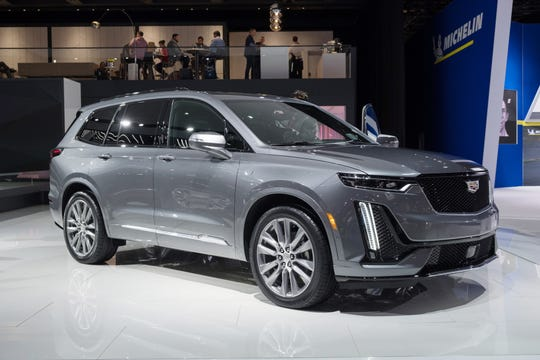 A 2020 Cadillac XT6 Sport sits on display during the 2019 North American International Auto Show held at Cobo Center in downtown Detroit on Tuesday, Jan. 15, 2019.  (Via OlyDrop)