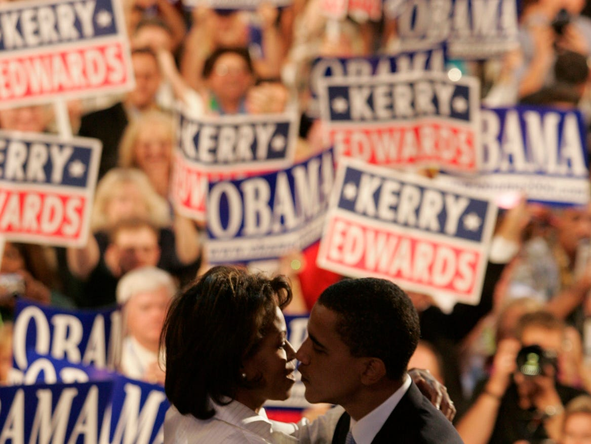 7/28/04 Boston, MA  -- Democratic National Convention at the FleetCenter -- Barack Obama,an Illinois Democrat running for the US Senate, kisses his wife Michelle after delivering the keynote speech on the second evening of the Democratic National Convention.   Eileen Blass, USA TODAY  ORG XMIT: DNC EB1398 (Via MerlinFTP Drop)
