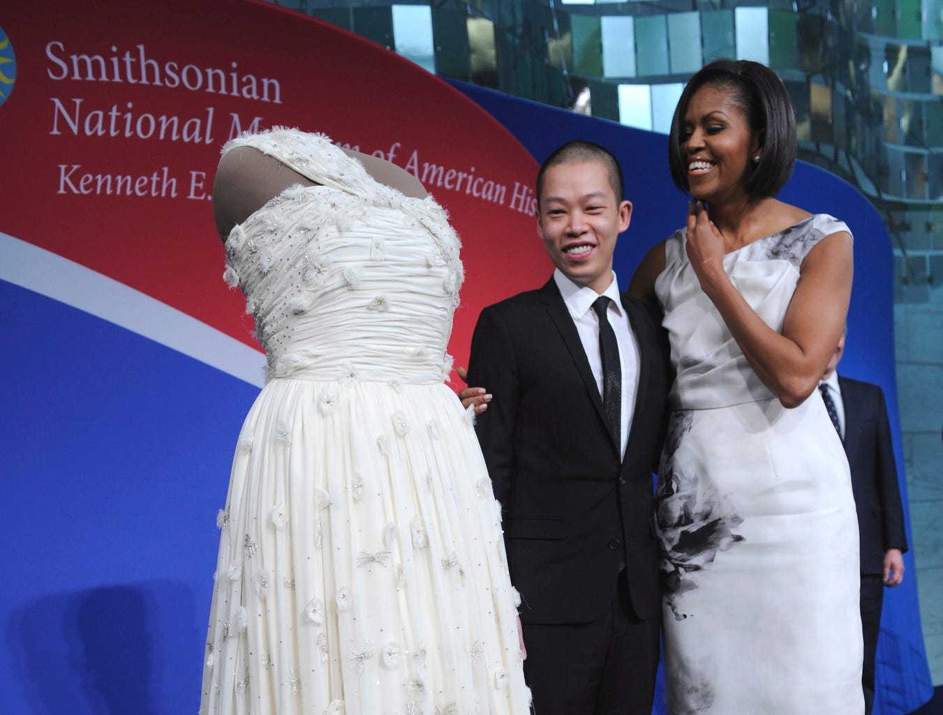 epa02072308 US First Lady Michelle Obama (R) and gown designer Jason Wu pose with the First Lady's inaugural gown during a ceremony to donate it to the Smithsonian National Museum of American History in Washington, DC USA 09 March 2010. The gown, designed by Jason Wu, joins the museum's collection of First Ladies gowns in a new gallery.  EPA/SHAWN THEW ORG XMIT: STX03
