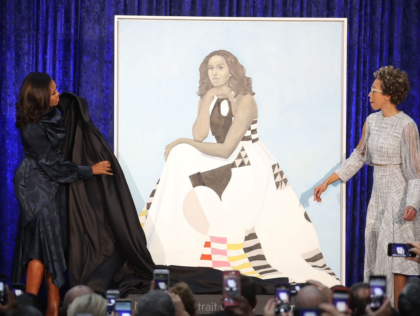 WASHINGTON, DC - FEBRUARY 12:  Former U.S. first lady Michelle Obama (L) and artist Amy Sherald unveil her portrait during a ceremony at the Smithsonian's National Portrait Gallery, on February 12, 2018 in Washington, DC. The portraits were commissioned by the Gallery, for Kehinde Wiley to create President Obama's portrait, and Amy Sherald that of Michelle Obama.  (Photo by Mark Wilson/Getty Images) ORG XMIT: 775109529 ORIG FILE ID: 917433482