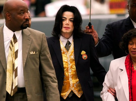 Michael Jackson arrives at the Santa Barbara County Courthouse for his child molestation trial in Santa Maria, Calif. on May 25, 2005.