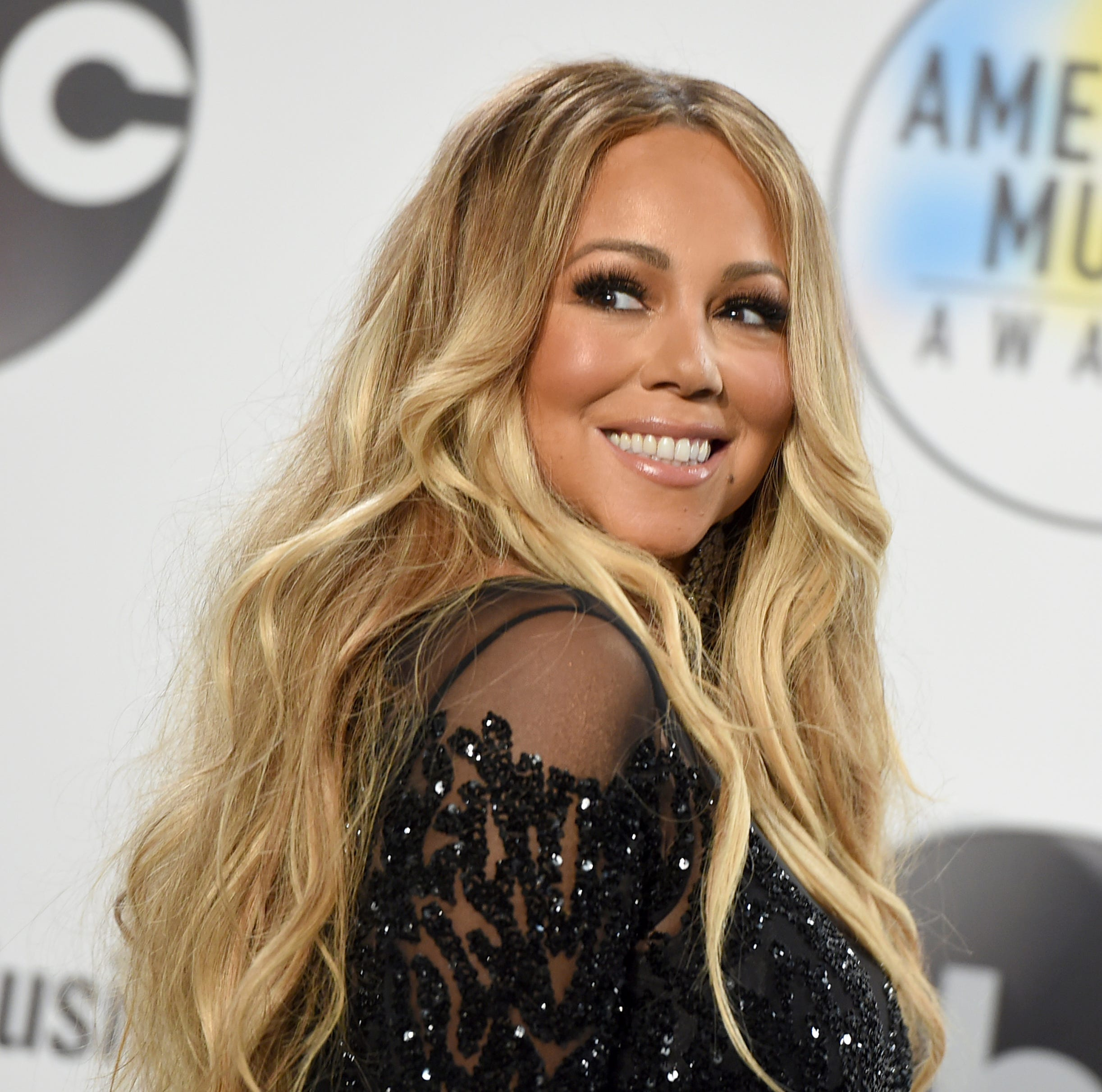 "FILE - In this Oct. 9, 2018 file photo, Mariah Carey poses in the press room at the American Music Awards at the Microsoft Theater in Los Angeles. Carey's 24-year-old Christmas classic is so popular it set a new one-day streaming record on Spotify on Christmas Eve. Chart Data reported that ""All I Want for Christmas Is You,"" released in 1994, was played 10.8 million times on Spotify on Monday, Dec. 24, 2018."