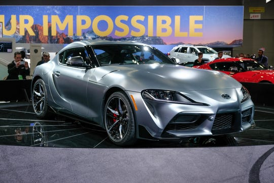 A 2020 Toyota Supra sits on the stage during the 2019 North American International Auto Show held at Cobo Center in downtown Detroit on Tuesday, Jan. 15, 2019.  (Via OlyDrop)