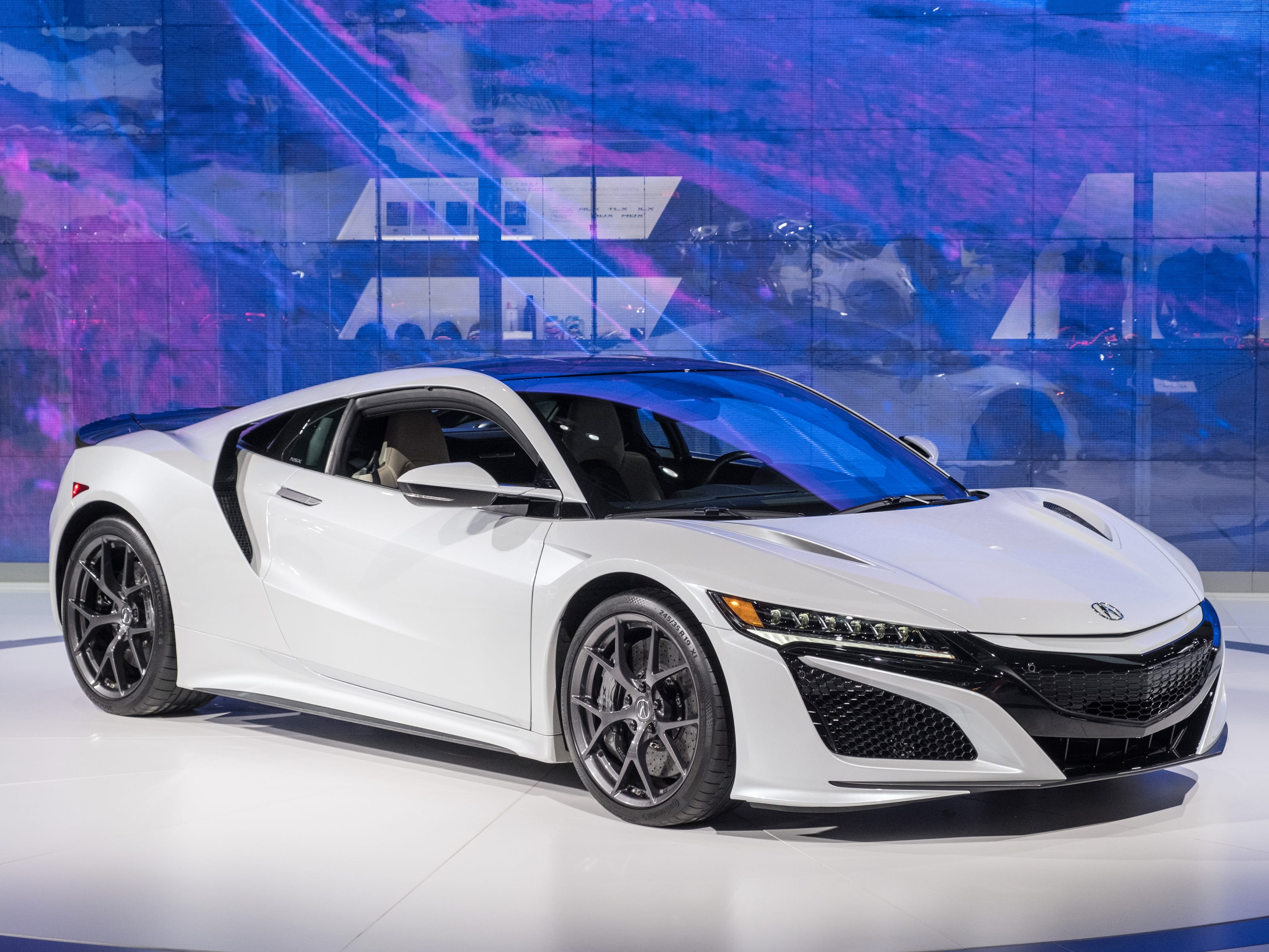 A 2019 Acura NSX sits on the stage during the 2019 North American International Auto Show held at Cobo Center in downtown Detroit on Tuesday, Jan. 15, 2019.  (Via OlyDrop)