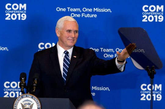 """Vice President Mike Pence wave to the audience, during the Global Chiefs of Mission Conference """"One Team, One Mission, One Future"""" at Department of State on Wednesday, Jan. 16, 2019, in Washington."""