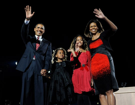 Democratic Presidential candidate Illinois Senator Barack Obama celebrates his victory over Republican nominee John McCain with his wife Michelle Obama and daughters Sasha and Malia Obama during election night victory celebration at Chicago's Grant Park on November 4, 2008.