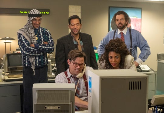 Whiz kid Blair Pfaff (Andrew Rannells), on phone, works his stock algorithm as Jammer Group employees Dawn (Regina Hall), front right, Yassir (Yassir Lester), rear left, Ronnie (Eugene Cordero) and Keith (Paul Scheer) watch.
