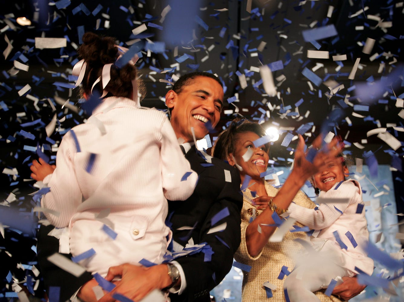 CHICAGO - NOVEMBER 2: Candidate for the U.S. Senate Barack Obama (D-IL) and his daughter Malia (L), wife Michelle and youngest daughter Sasha (R) celebrate his victory with supporters over Repulican rival Alan Keyes November 2, 2004 in Chicago, Illinois. Obama was expected to easily defeat Keyes in this first ever senate race featuring two major-party African-American candidates. (Photo by Scott Olson/Getty Images)