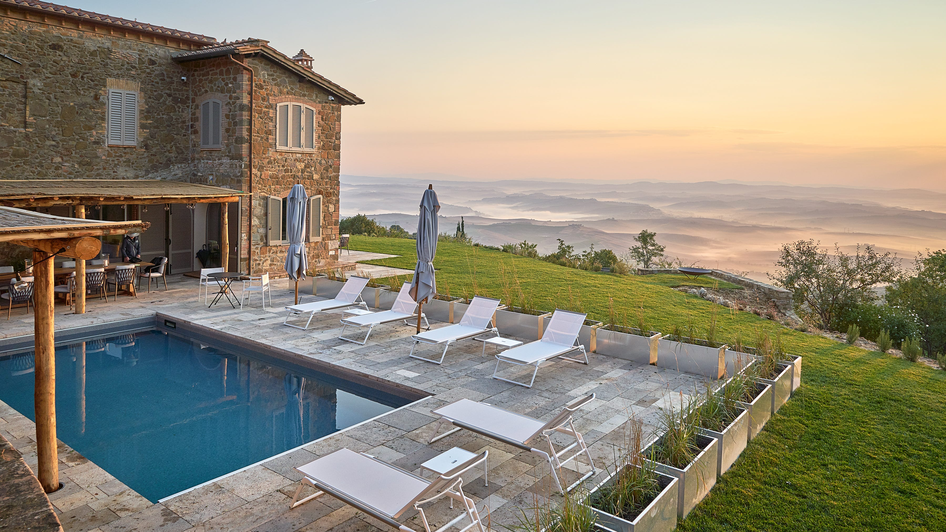 This villa in Val d'Orcia has four bedrooms and five baths.