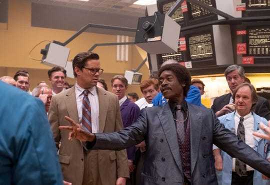 Whiz kid Blair Pfaff (Andrew Rannells), left, watches as Wall Street fixture Maurice Monroe (Don Cheadle) holds court on the trading floor in Showtime's 'Black Monday.'
