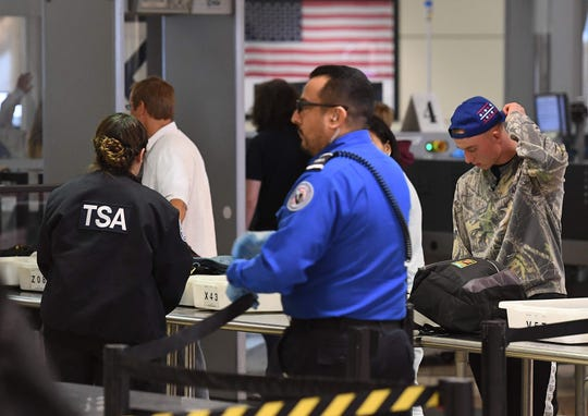 Transportation Security Administration agents work unpaid on Dec. 22, 2018, in Los Angeles.