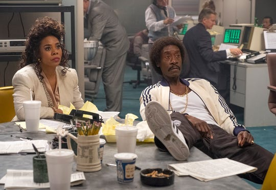 Jammer Group chief Maurice Monroe (Don Cheadle), right, and his savviest trader, Dawn Darcy (Regina Hall), follow the markets in Showtime's 'Black Monday.'