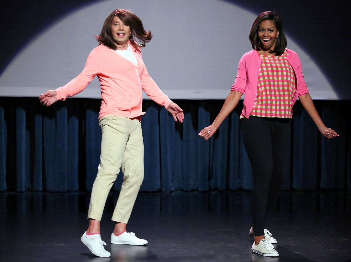 """Host Jimmy Fallon and First Lady Michelle Obama during the """"Evolution of Mom Dancing Part 2"""" skit on """"The Tonight Show Starring Jimmy Fallon"""" April 2, 2015.  CREDIT: Douglas Gorenstein, NBC ORG XMIT: Season: 2 [Via MerlinFTP Drop]"""