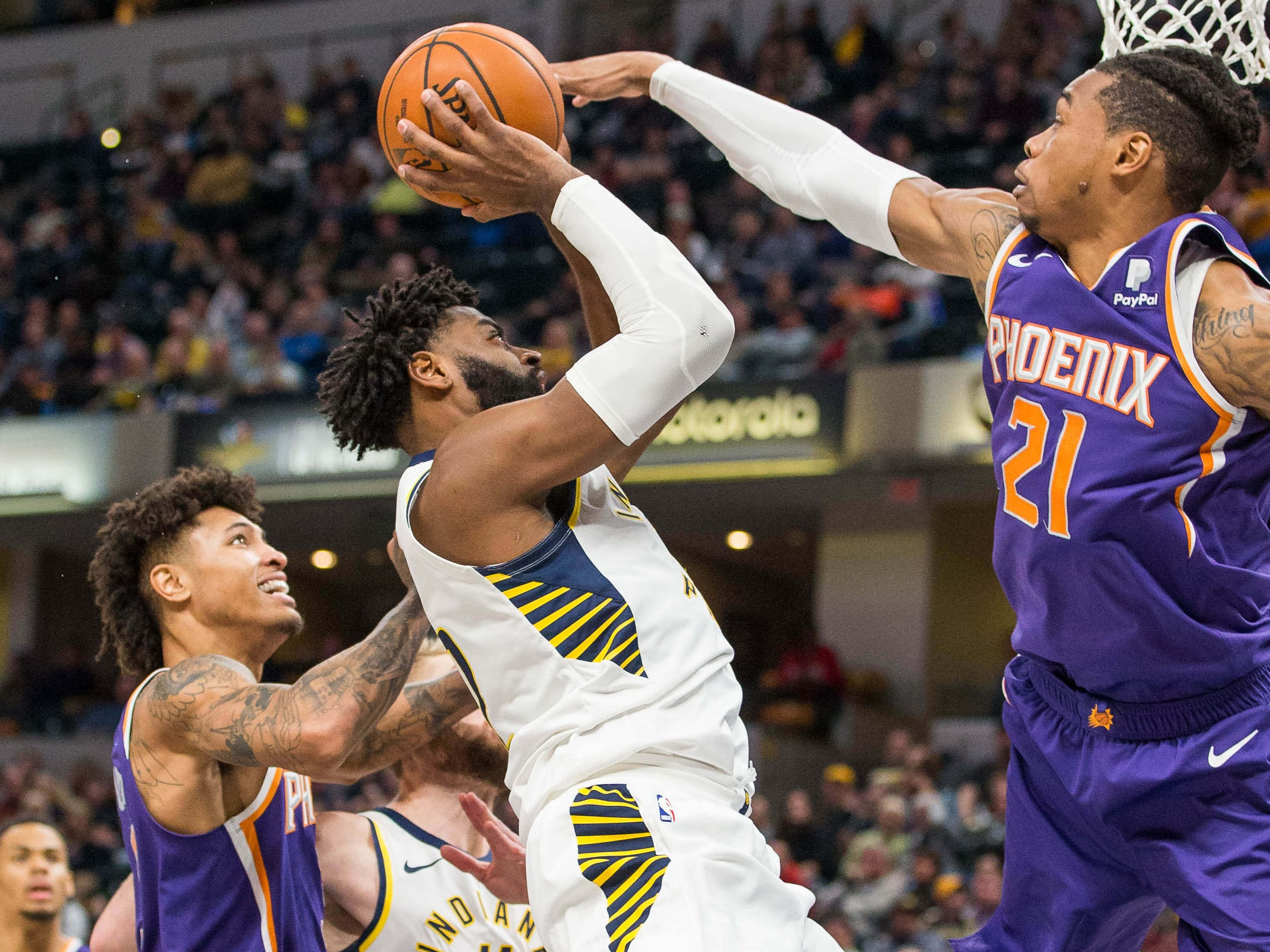 Jan. 15: Pacers guard Tyreke Evans (12) tries to shoot over Suns defender Richaun Holmes (21) during the second half at Bankers Life Fieldhouse in Indianapolis.