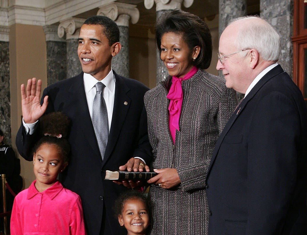 WASHINGTON - JANUARY 4:  U.S. Senator Barack Obama (D-IL) (2nd L) poses for with his wife Michelle (2nd R), Vice President Dick Cheney (R), daughters (C) Malia and Sasha during the reenactment of a swearing -in ceremony on Capitol Hill January 4, 2005 in Washington, DC. The 109th Congress was sworn in January 4.  (Photo by Alex Wong/Getty Images)
