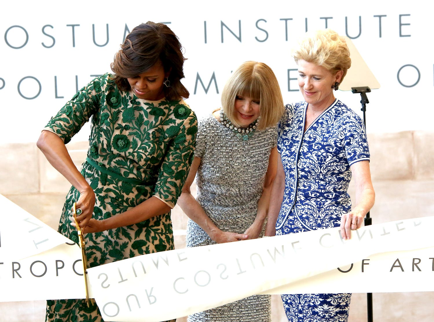 NEW YORK, NY - MAY 05:  (L-R) First Lady of the United States Michelle Obama, Vogue Editor in Chief Anna Wintour and Metropolitan Museum of Art President Emily K. Rafferty attend the Anna Wintour Costume Center Grand Opening at the Metropolitan Museum of Art on May 5, 2014 in New York City.  (Photo by Paul Zimmerman/WireImage) ORG XMIT: 487575389 ORIG FILE ID: 488285747