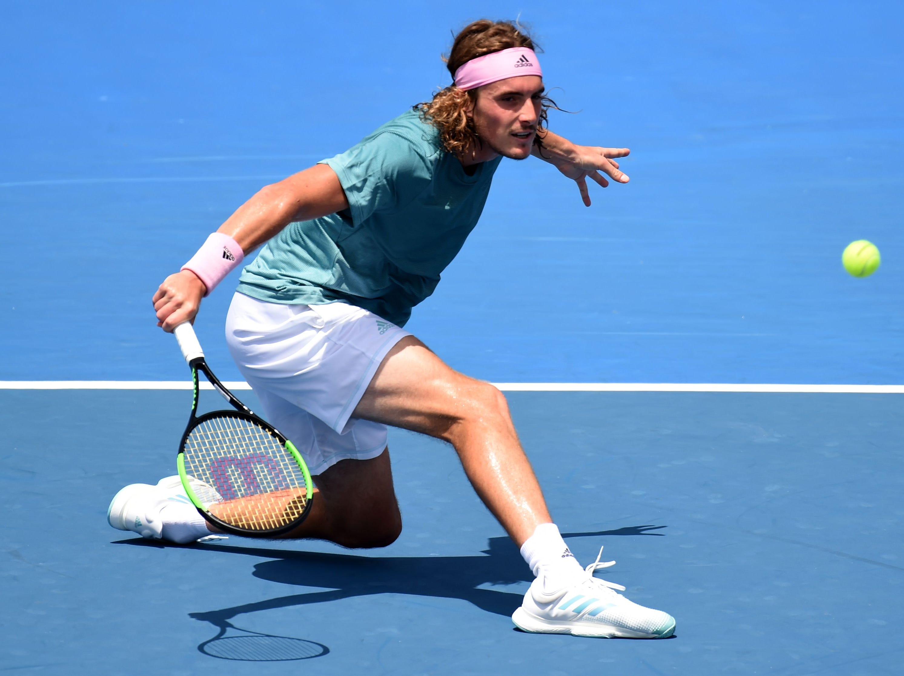 No. 14 Stefanos Tsitsipas of Greece plays a backhand during his 6-3, 2-6, 6-2, 7-5 second-round victory over Serbia's Viktor Troicki.