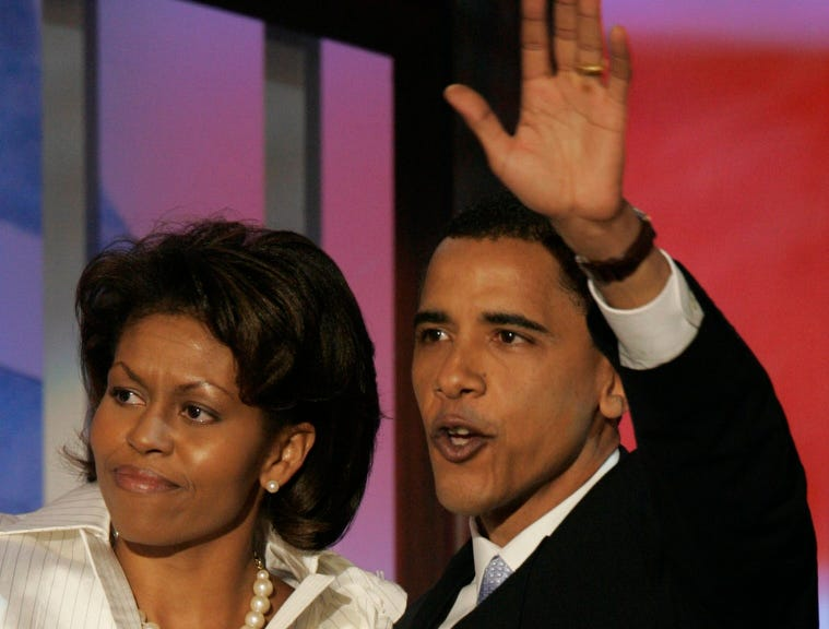"""7/27/04 Boston,MA-DNC -Barack Obama, candidate for a Senate seat in Illinois and one of the keynote speakers of the 2004 Democratic National Convention, waves with his wife Michelle after he addressed delegates during the second night of the event at the FleetCenter in Boston, July 27, 2004. Obama a rising political star took center stage at the Democratic National Convention on Tuesday and told delegates of the """"improbable love"""" between his African father and white mother and his own unlikely rise in the party. Although little known outside his home state of Illinois, U.S. Senate candidate Barack Obama has won rave reviews for his charisma and cross racial appeal as he campaigns to become only the third black senator since the 19th century. The son of a Kenyan father and a white American mother was there because he is favored to win a Senate seat in the key Midwest industrial state in November, picking up a Republican seat in the closely divided U.S. Senate.    --Photo by Tim Dillon, USA TODAY. (Via MerlinFTP Drop)"""