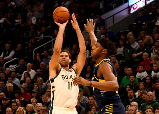 Brook Lopez shoots against Myles Turner.