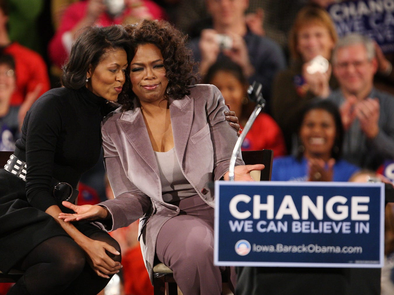 DES MOINES, IA - DECEMBER 8:  Talk show host Oprah Winfrey (L) and Michelle Obama embrace at a rally for her husband Democratic presidential hopeful Sen. Barack Obama (D-IL)  December 8, 2007 in Des Moines, Iowa. Obama and Winfrey are scheduled to make two stops in Iowa before heading off to campaign events in South Carolina and New Hampshire tomorrow.  (Photo by Scott Olson/Getty Images)