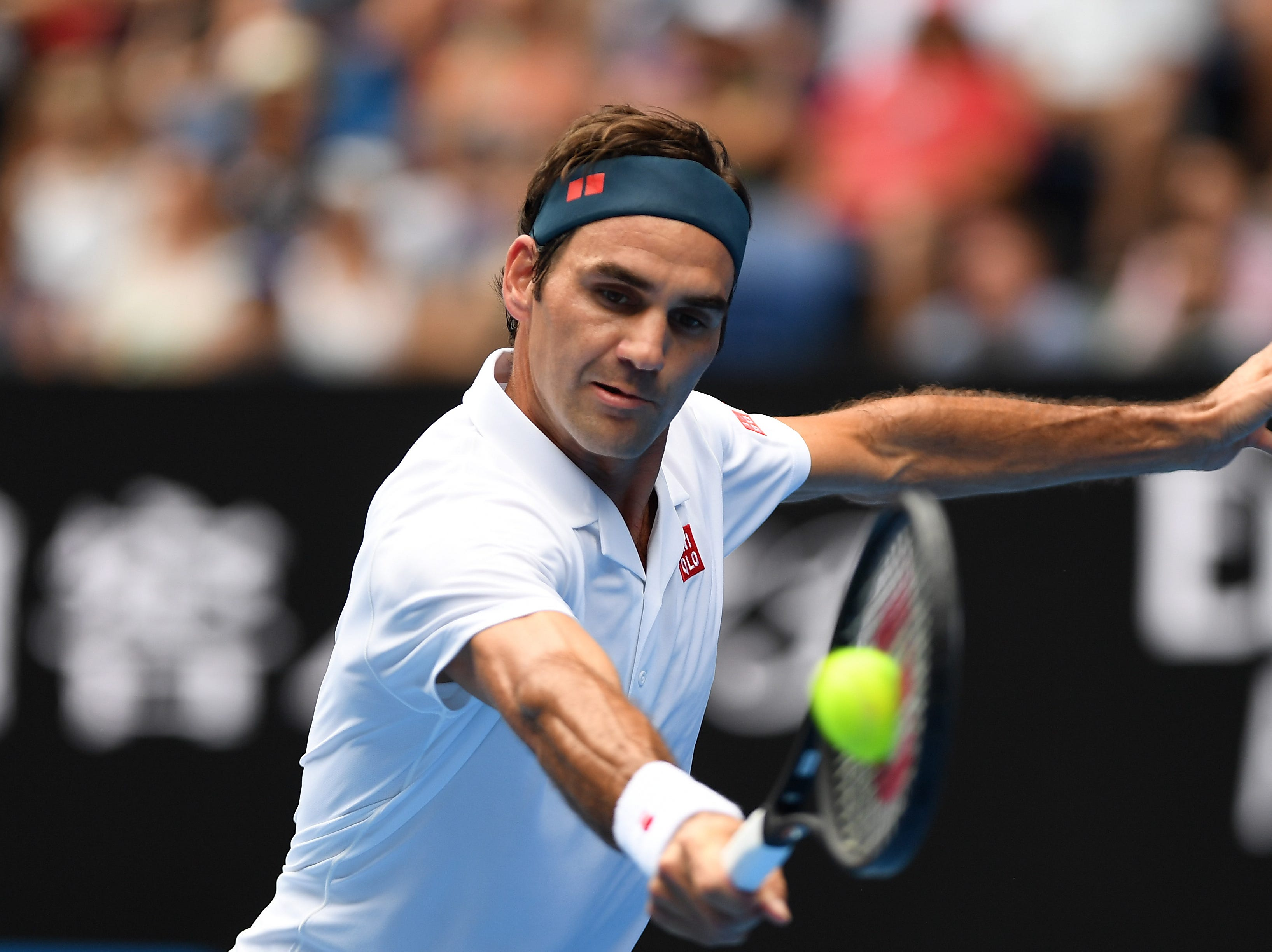 Roger Federer in action against Daniel Evans during their second round match.