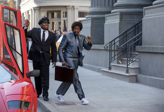 Wall Street trader Maurice Monroe (Don Cheadle), right, exits his Lambo limo in Showtime's 'Black Monday.'