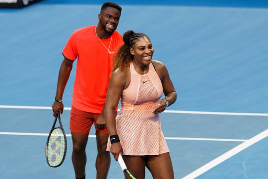 Serena Williams and Frances Tiafoe of the United States smile during their mixed doubles match against Stefanos Tsitsipass and Maria Sakkari of Greece at the Hopman Cup in Perth, Australia, on Dec. 31, 2018.
