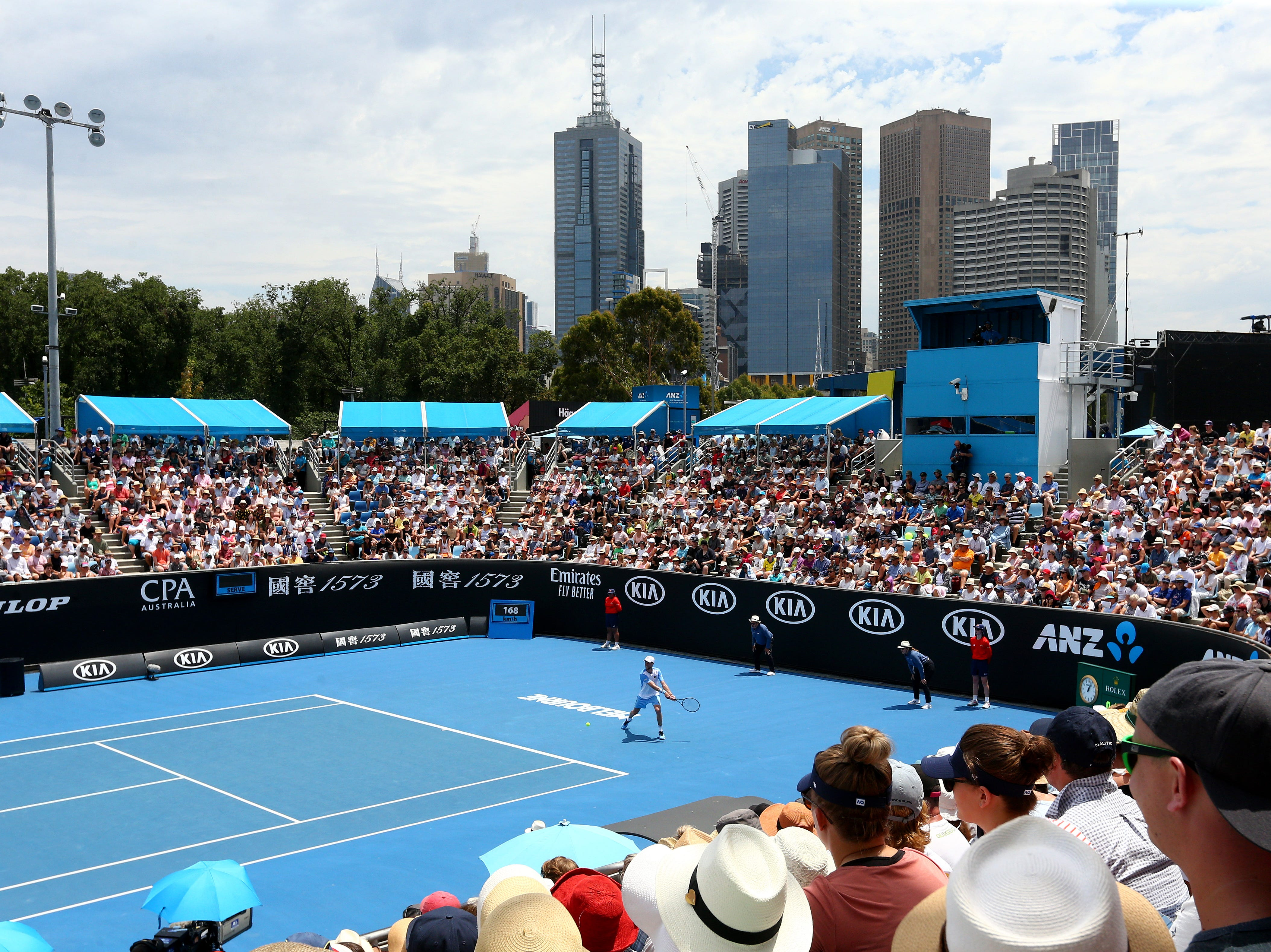 Melbourne high rises soar in the background of 1573 Arena during Day 3 of the Australian Oepn.