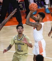 Clemson guard Shelton Mitchell (4) shoots near Georgia Tech guard Michael Devoe(0) during the first half at Littlejohn Coliseum in Clemson Wednesday, January 16, 2019.