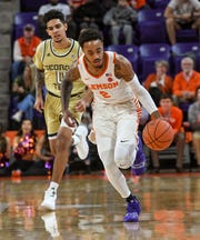 Clemson guard Marcquise Reed (2) dribbles near Georgia Tech guard Michael Devoe(0) during the first half at Littlejohn Coliseum in Clemson Wednesday, January 16, 2019.