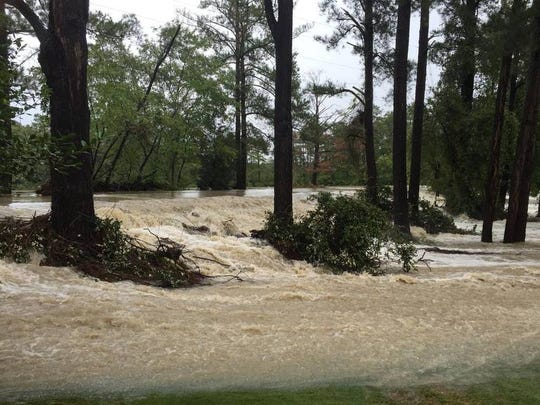 Failing dams can release a deluge of water, as is pictured here from a 2015 flood in Columbia.