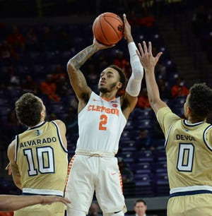 Clemson guard Marcquise Reed (2) shoots near Georgia Tech guard Jose Alvarado (10) during the first half at Littlejohn Coliseum in Clemson Wednesday, January 16, 2019.