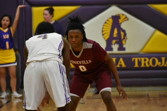 Pineville's Jarrell Dorsey (0) guards ASH's Latrell Holly during Tuesday's game.