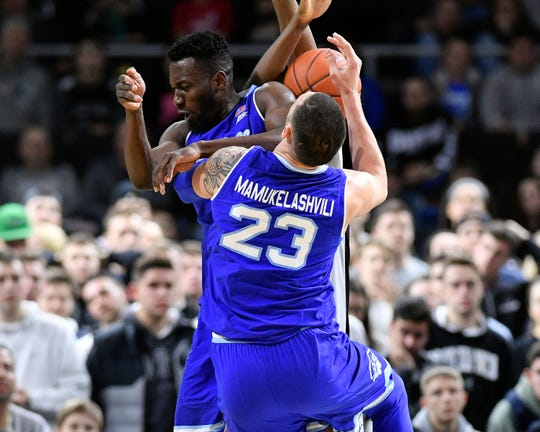 Seton Hall Pirates forward Sandro Mamukelashvili (23) runs into guard Quincy McKnight (0) during the second half of a game against Providence