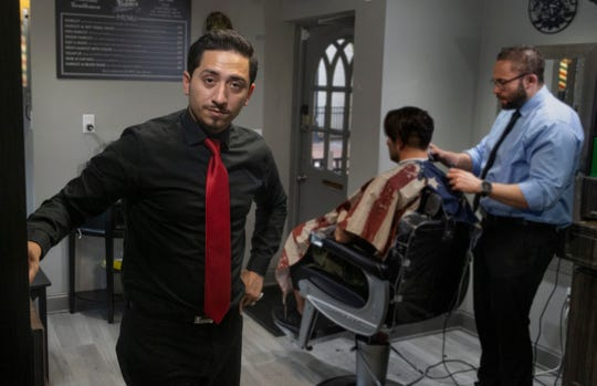 Alex Aviles (foreground) after finishing with a customer at the Red Bank location of Evilfades on January 16, 2019. They also have a shop in Millstone.
