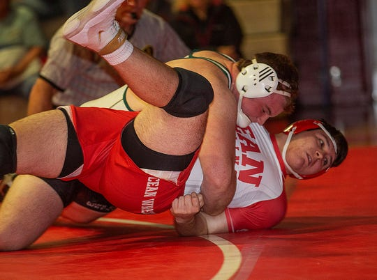 Long Branch heavyweight Kevin Cerruti (left), shown wrestling Ocean's Joseph Terresi on Jan. 9, helped Long Branch rally for a win at Manalapan Wednesday night with a pin.