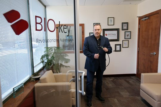 Scott Mahnken, vice president of marketing for BIO-key International, an over 25-year-old, Wall-based developer of fingerprint biometric authentication and security solutions used by a broad range of leading companies worldwide, showcases the company's products, including a fingerprint bike lock, in Wall, NJ Thursday January 17, 2019.
