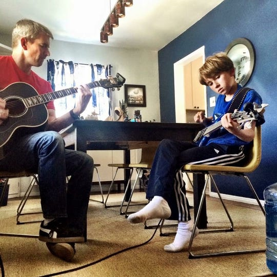 Michael Broderick (left) and his son Michelangelo jam on guitars at their Los Angeles home.