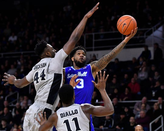 Seton Hall Pirates guard Myles Powell (13) attempts a layup in front of Providence Friars guard Isaiah Jackson (44) and guard Alpha Diallo (11)