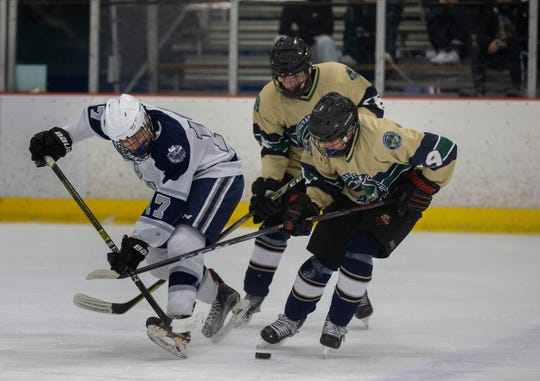 Manssquan's Ryan Scott and Freehold's Anthony Caruso battle for puck in first period action. Manasquan Ice Hockey vs Freehold/Raritan/Colts Neck Varsity Ice Hockey in Wall, NJ on January 16, 2019.