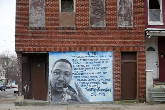A memorial mural is painted on one of many abandoned buildings along Martin Luther King Jr. Boulevard in Trenton, NJ Wednesday January 16, 2019.