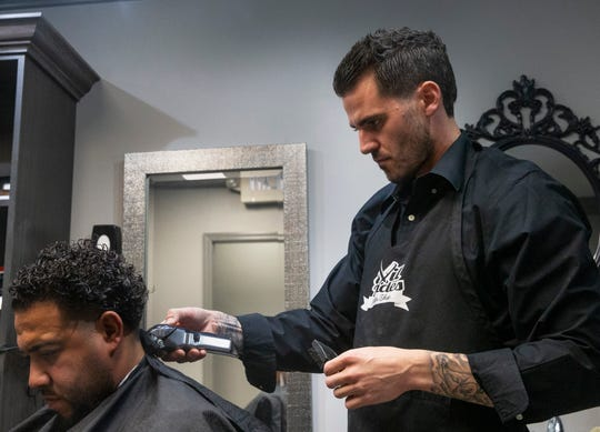 Andrew Evilsizor, the owner of Evilfades,  works on a customer at their Red Bank location on January 16, 2019. They also have a shop in Millstone.