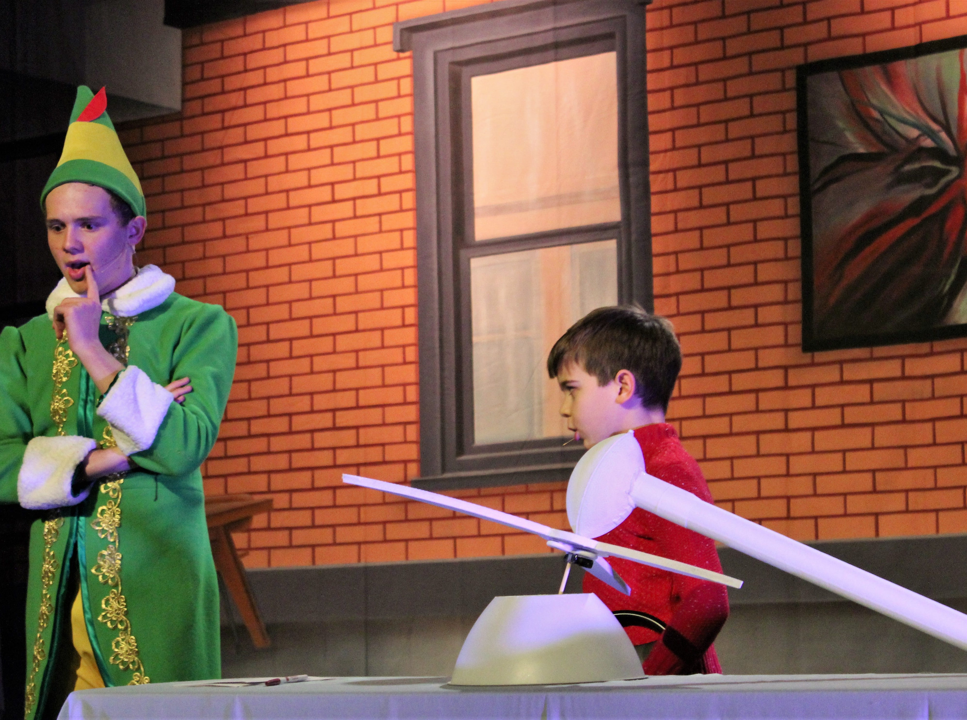 "Michael Hobbs (Phoenix Lowe, right)) has assembly problems that Buddy (Brent Bardin) can solve ... if Michael will write a letter to Santa, in this rehearsal scene from ""Elf, the Musical, Jr."" It opens Friday at the Paramount Theatre."