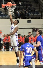 ACU's Jalone Friday layups a basket in the first half against Houston Baptist. ACU beat the Huskies 75-68 in the Southland Conference game Wednesday, Jan. 16, 2019, at Moody Coliseum.