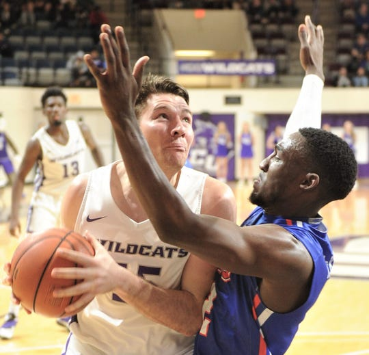 ACU's Hayden Farquhar, left, drives to the basket against a Houston Baptist defender. ACU beat the Huskies 75-68 in the Southland Conference game Wednesday, Jan. 16, 2019, at Moody Coliseum.