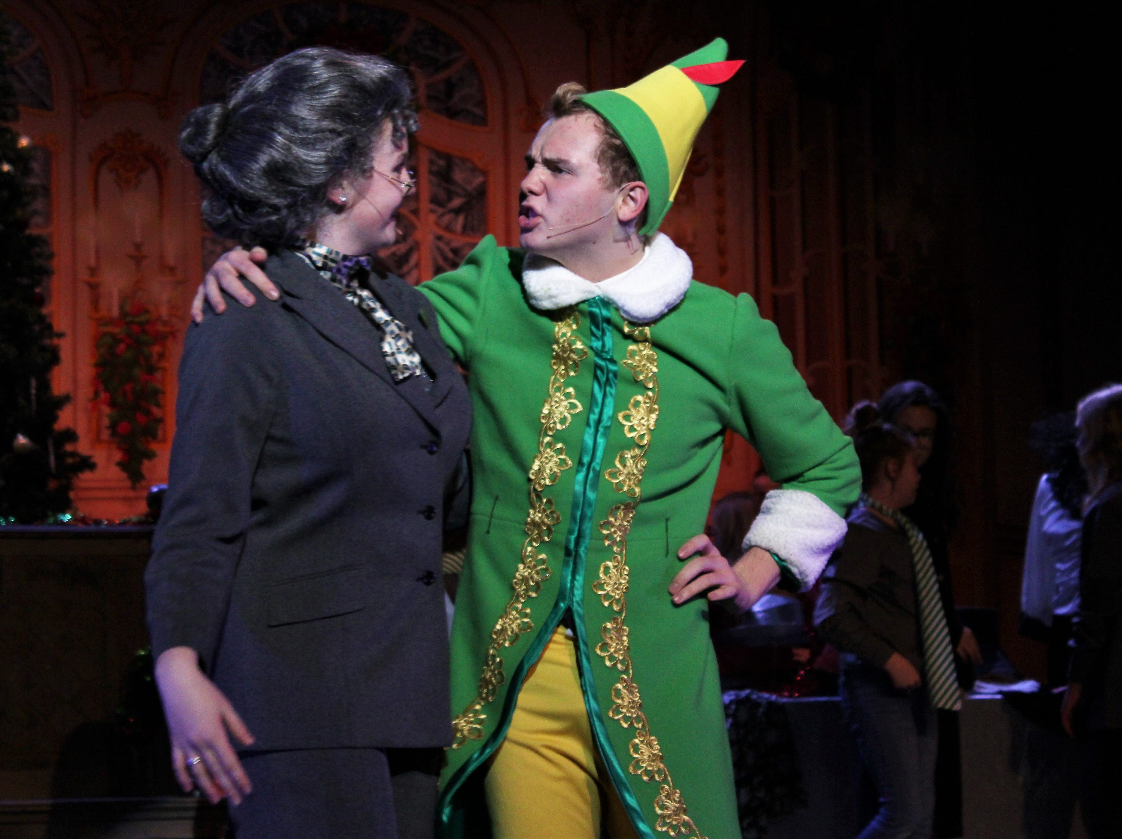 "The department store manager (Graci Melbourne) gets clued in by an oversized elf (Brent Bardin) in this rehearsal scene from ""Elf, the Musical, Jr."" at the Paramount Theatre."