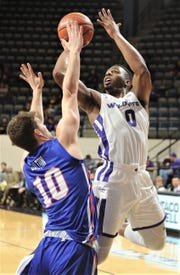 ACU's Jalen Franklin, right, puts up a shot while being defended by Houston Baptist's Ty Dalton in the second half. ACU beat the Huskies 75-68 in the Southland Conference game Wednesday, Jan. 16, 2019, at Moody Coliseum.